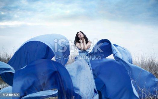 Young woman in beautiful dress outdoors