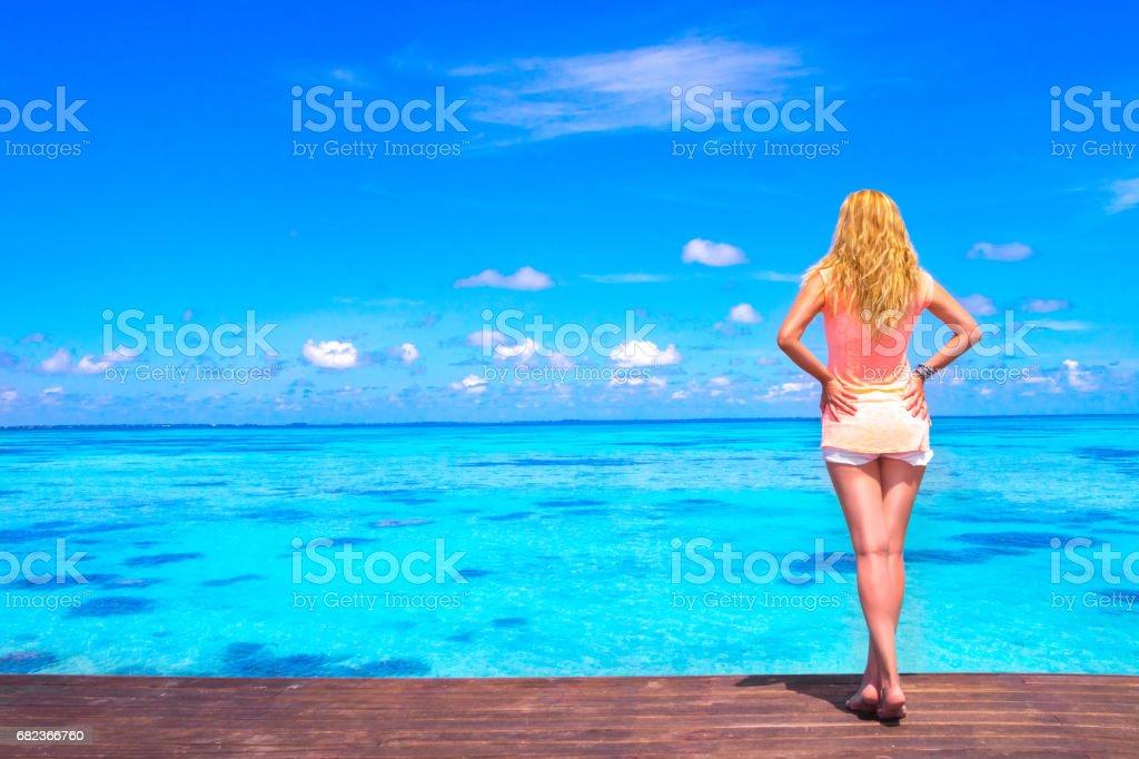 Dreamscape Escape with beauty girl on Maldives zbiór zdjęć royalty-free
