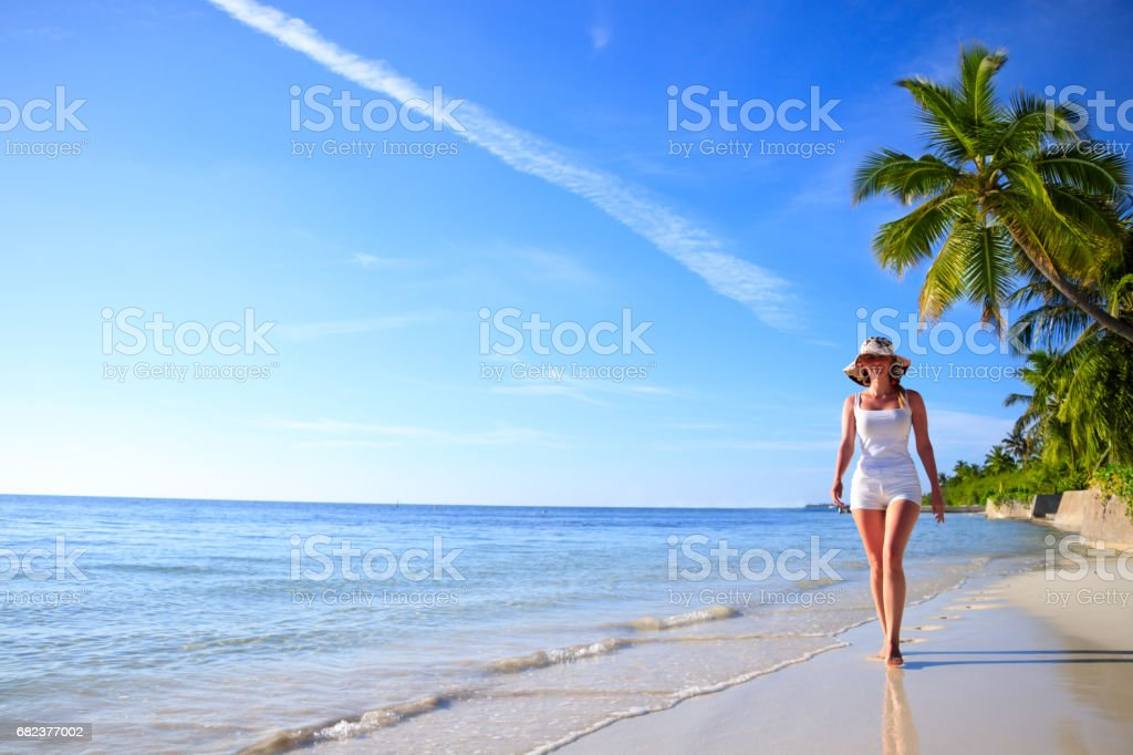 Dreamscape Escape with beauty girl on Maldives foto stock royalty-free