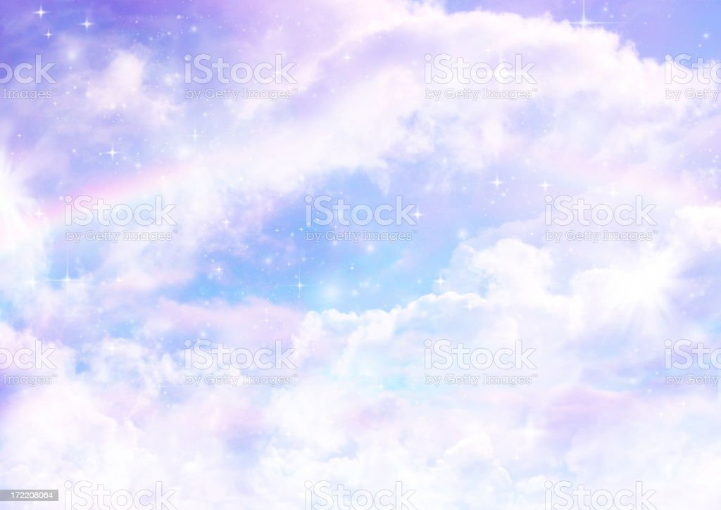 dreamscape with rainbows clouds and stars royalty-free stock photo