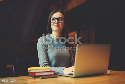 istock Dreamy attractive female student thinking about coursework strategy 693210204