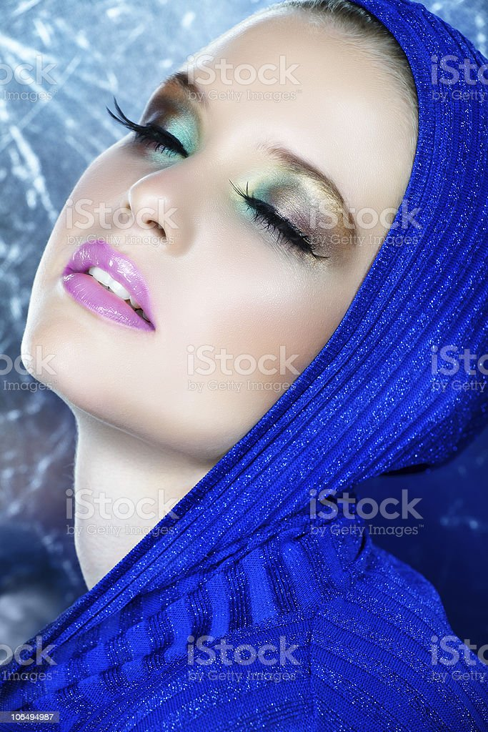 dreamy beautiful woman in blue royalty-free stock photo