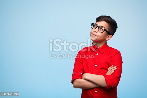istock Dreamy boy with arms crossed 687472788