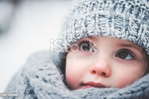istock dreamy cozy outdoor portrait of toddler child girl in winter 497534862