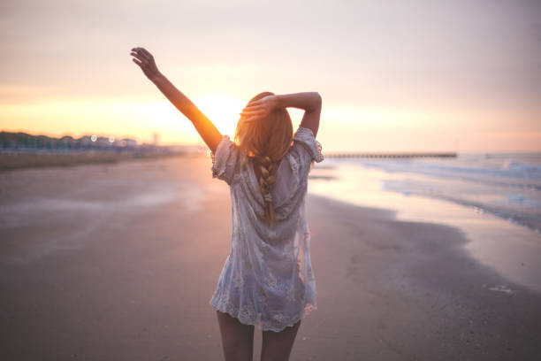 dreamy girl  on beach - beach fashion stock photos and pictures