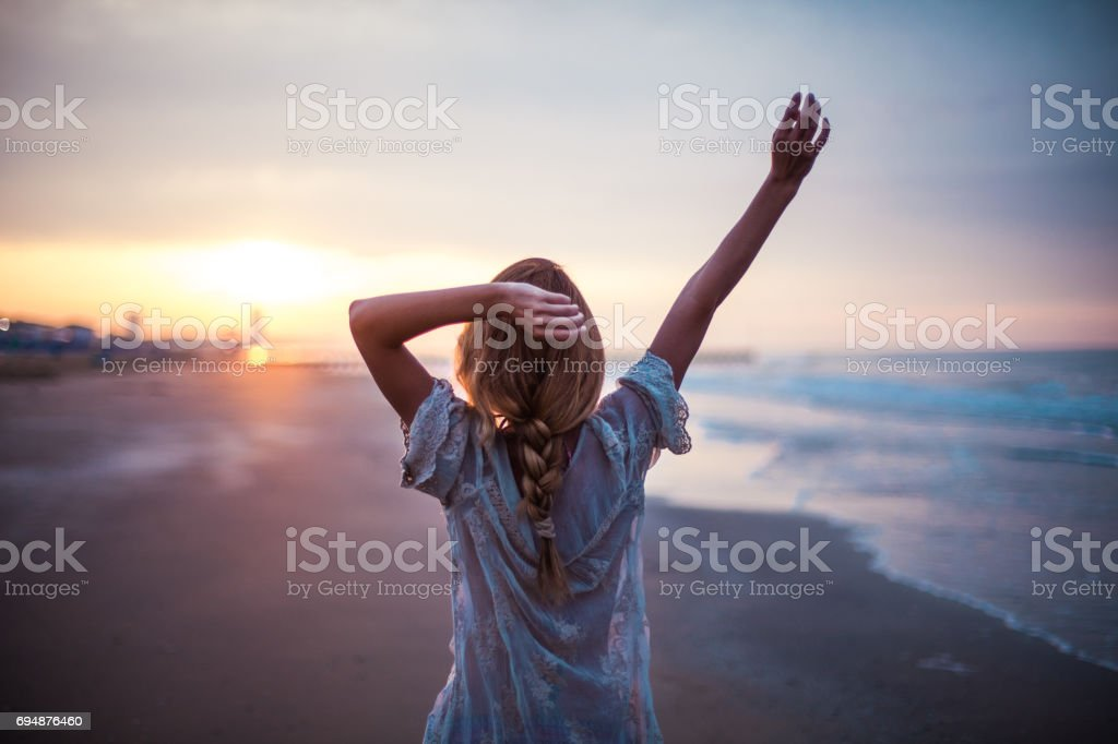 Dreamy girl  on beach stock photo