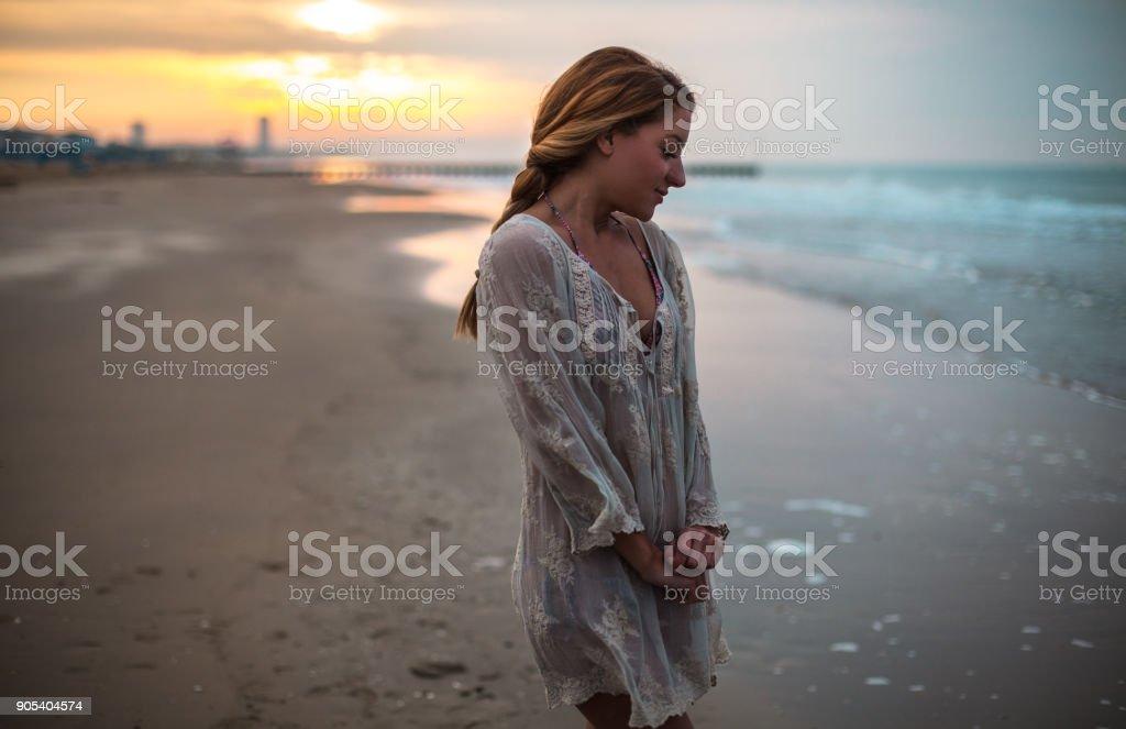 Dreamy girl on beach stock photo