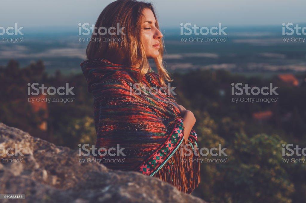 Dreamy hippie girl outdoors stock photo