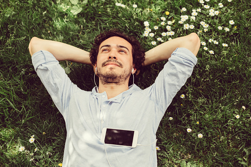 Dreamy Man In The Grass Stock Photo - Download Image Now