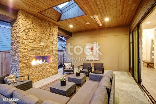 istock Dreamy outdoor covered patio with stone fireplace 875183394