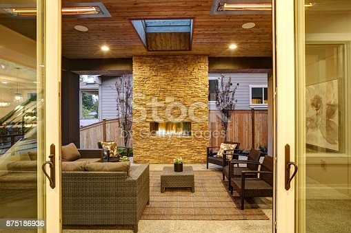 istock Dreamy outdoor covered patio with stone fireplace 875186936