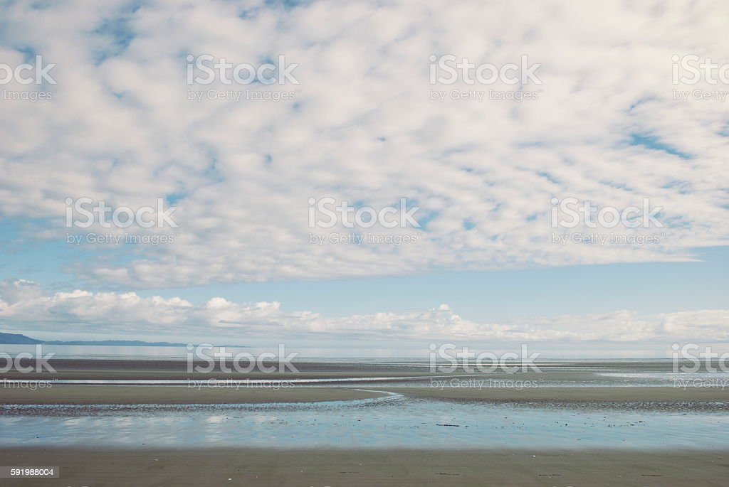 Dreamy Pastel Cloud Horizon Sand and Sea Background stock photo