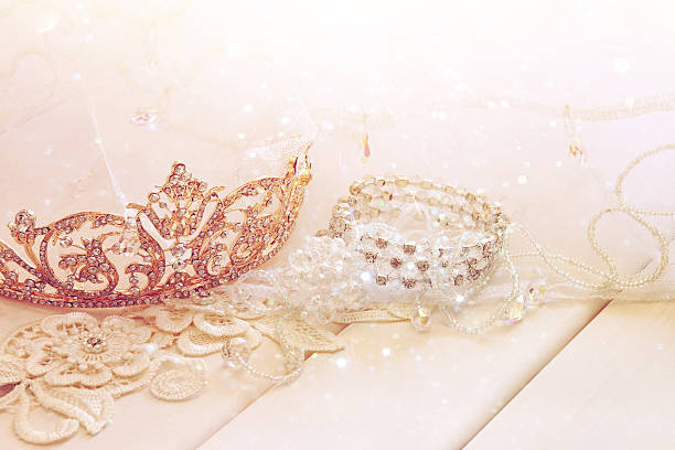 dreamy photo of crystal jewellery and diamond tiara - prinzessin tiara stock-fotos und bilder