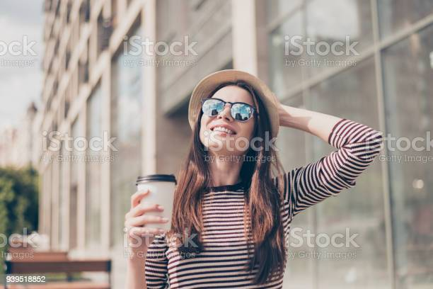 Dreamy relaxed young girl is having a coffee and walking in the picture id939518852?b=1&k=6&m=939518852&s=612x612&h= ttdcfhxzsdkvbf n7cdcnxozv q8wic76jrk1fh s4=