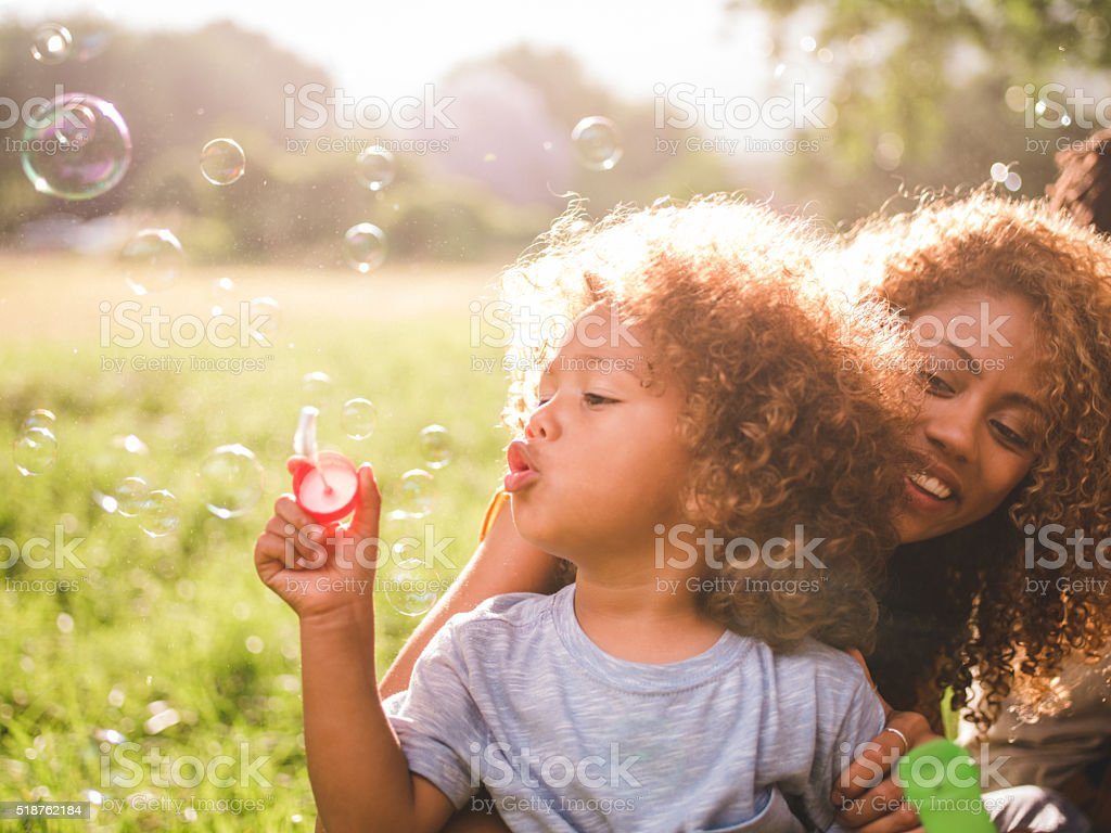 Dreamy soft intimate moment between a mother and her boy stock photo