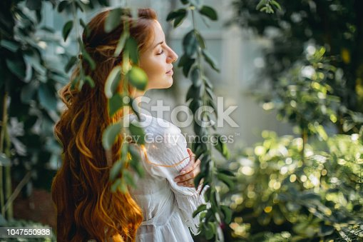 Dreamy woman in tropical environment