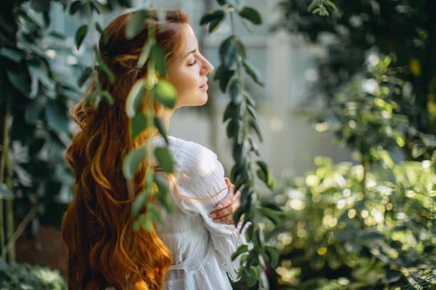 dreamy woman in tropical environment - woman portrait forest foto e immagini stock