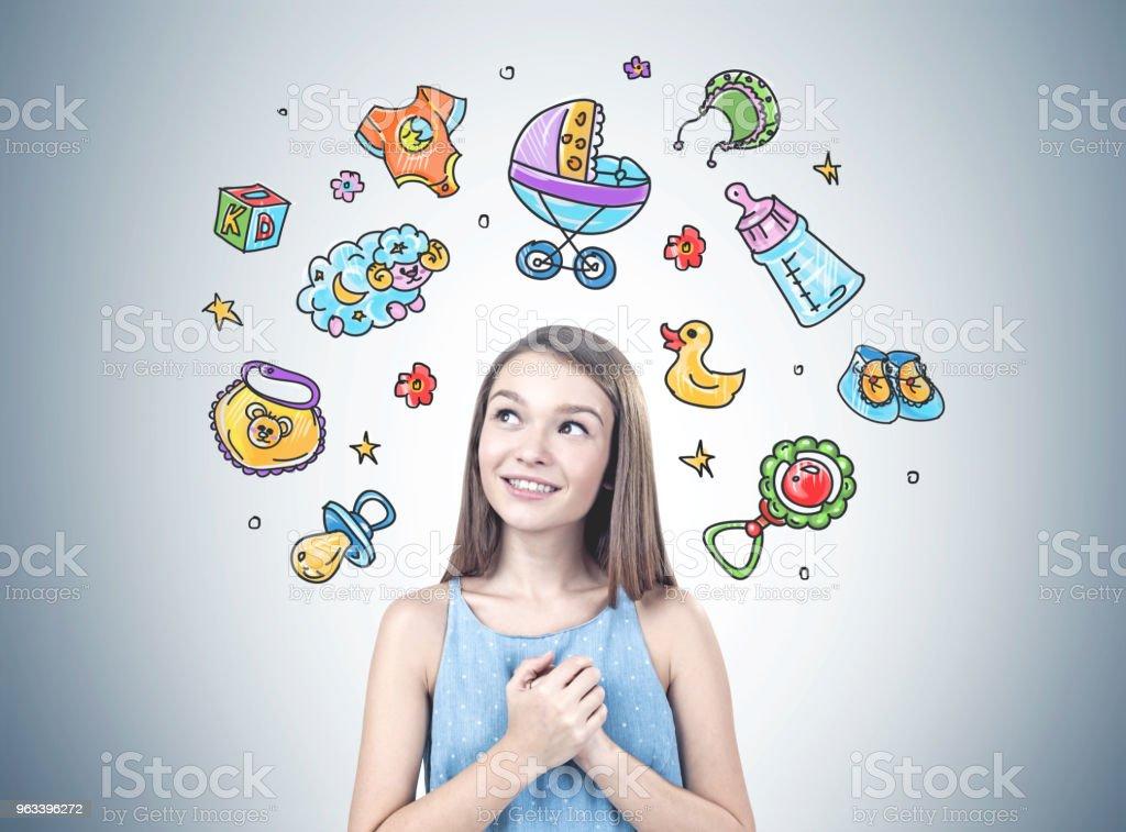 Dreamy young girl wants a baby - Zbiór zdjęć royalty-free (Broszura)