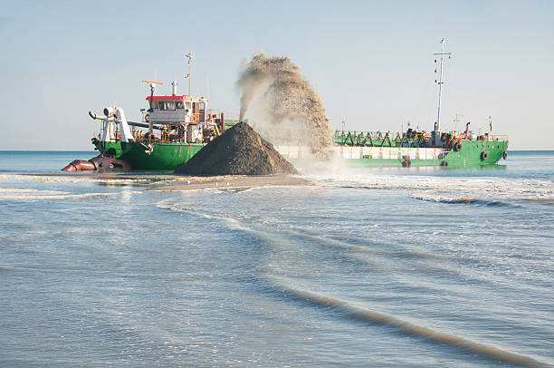 Dredge in action on the river stock photo