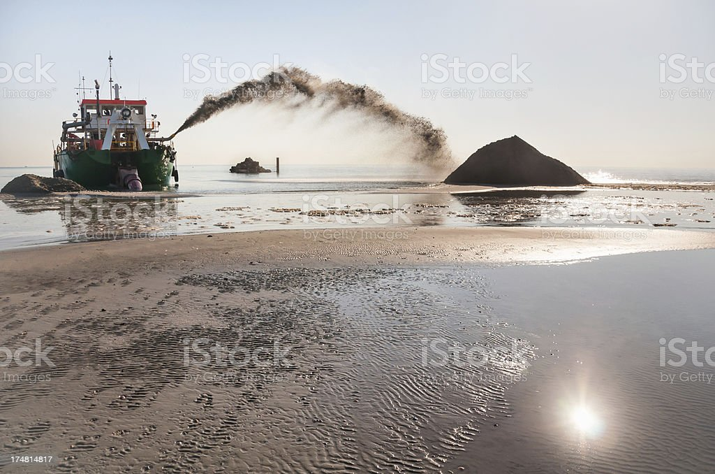 Dredge in action royalty-free stock photo