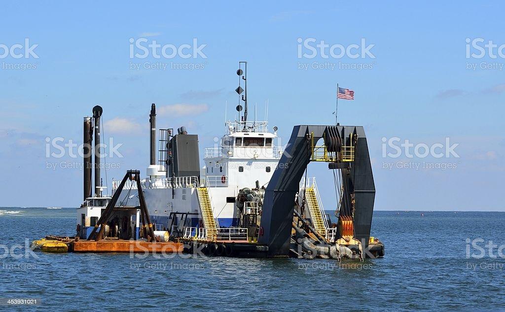 Dredger at ocean inlet stock photo