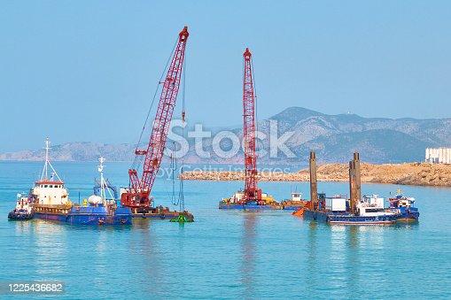 dredger floating platforms and other vessels on sea dredging works.