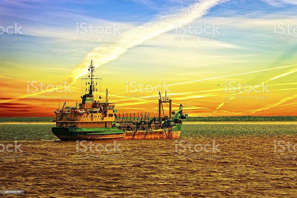 Dredger ship in port stock photo