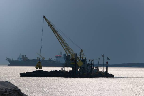 dredgers at work near the port of rotterdam - boskalis stockfoto's en -beelden