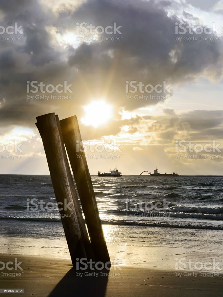 dredgers in the late afternoon sun stock photo