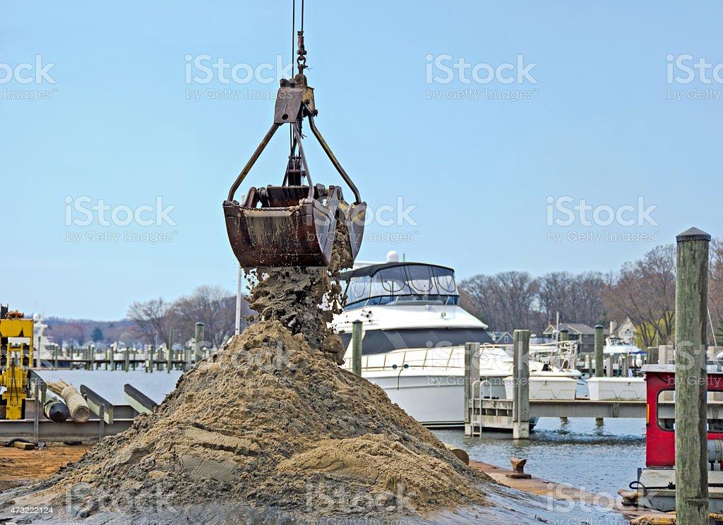 dredging a marina boat slip stock photo