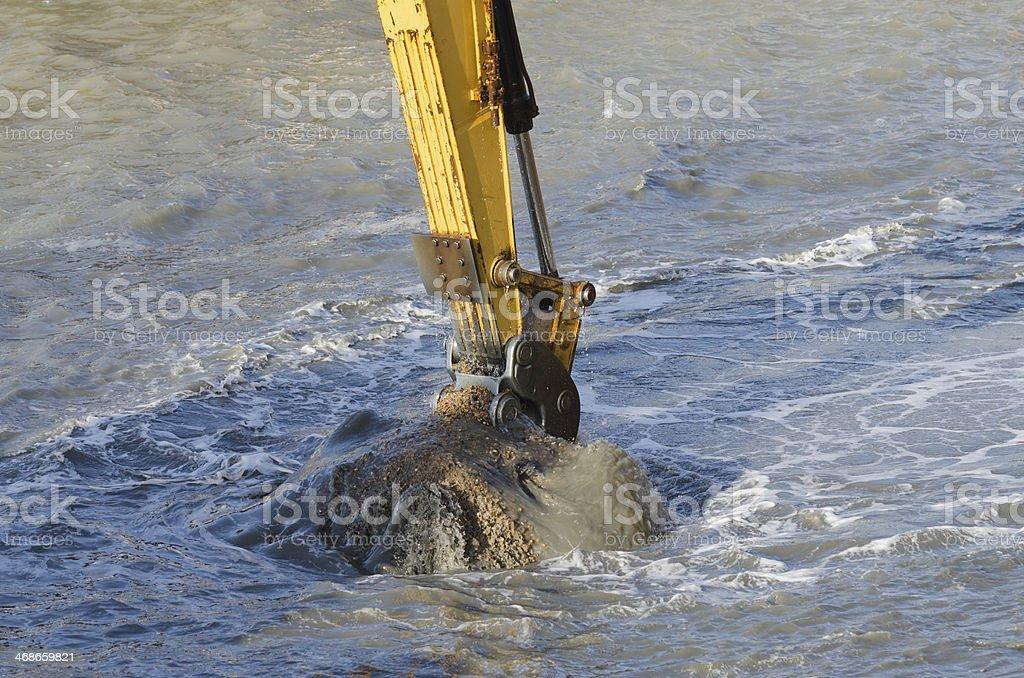 Dredging harbor with excavator stock photo