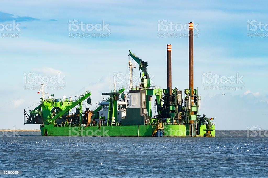 dredging vessel stock photo