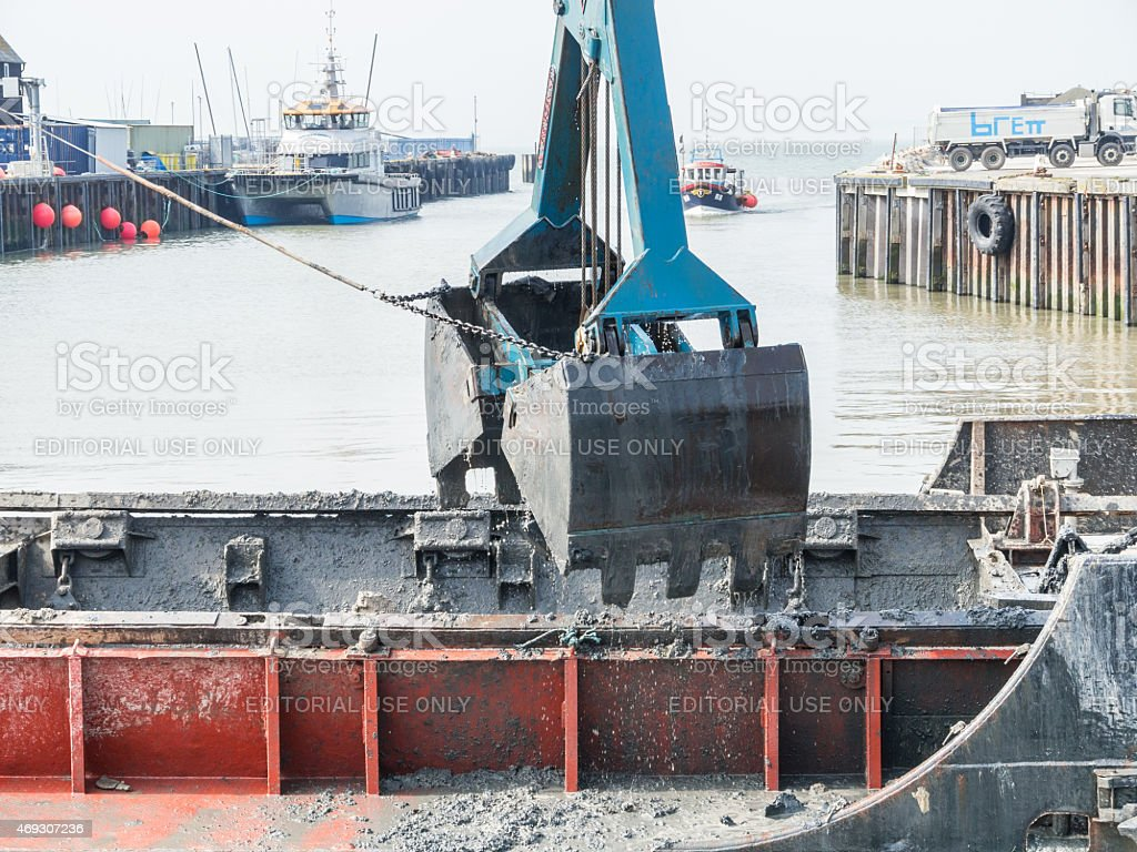 Dredging Whitstable Harbour stock photo
