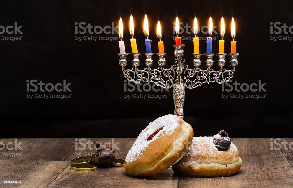 Dreidels and a menorah for Hanukkah. Text-Israel stock photo