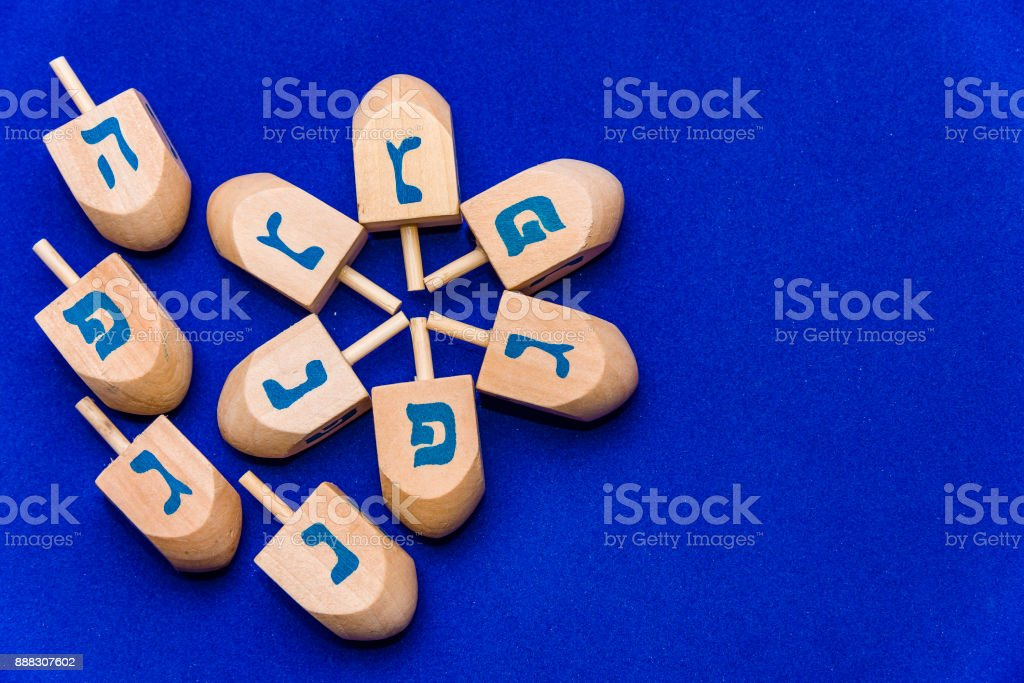 Dreidels for Hanukkah a blue background stock photo