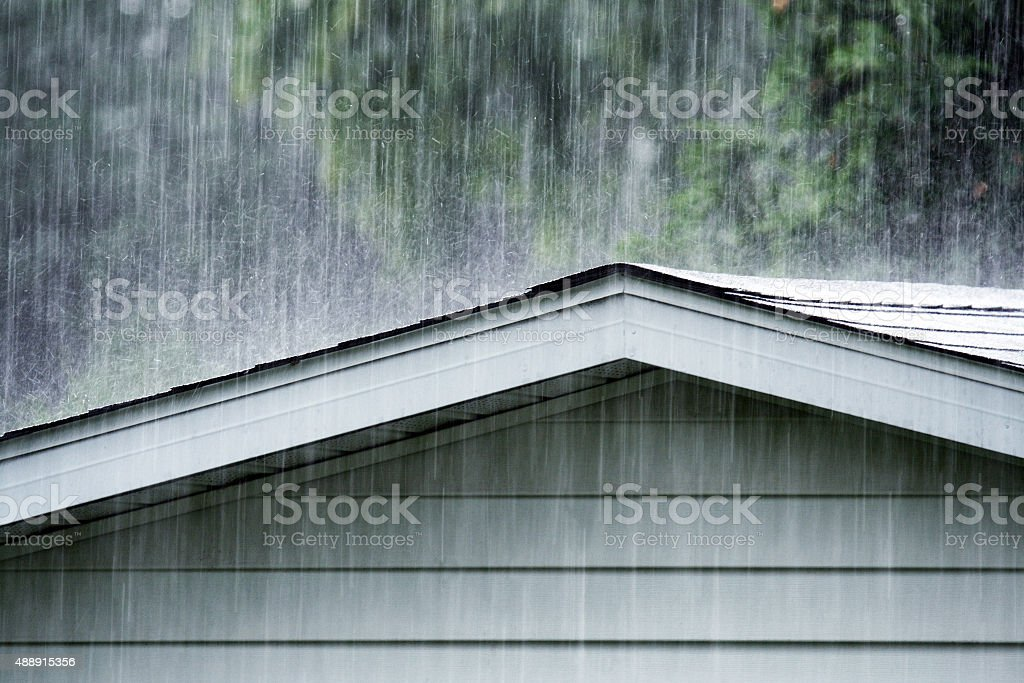 Drenching Rain Storm Downpour on Old Shed Roof stock photo