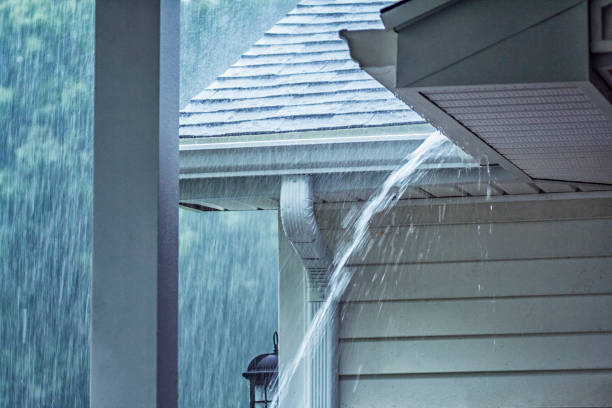 Drenching Rain Storm Water Overflowing Roof Gutter stock photo