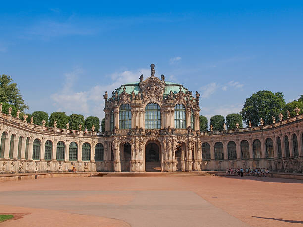 Dresden Zwinger Dresden, Germany - June 11, 2014: Tourists visiting the Dresdner Zwinger palace designed by Poeppelmann in 1710 as orangery and exhibition gallery completed by Gottfried Semper with the addition of Semper Gallery in 1847 zwanger stock pictures, royalty-free photos & images