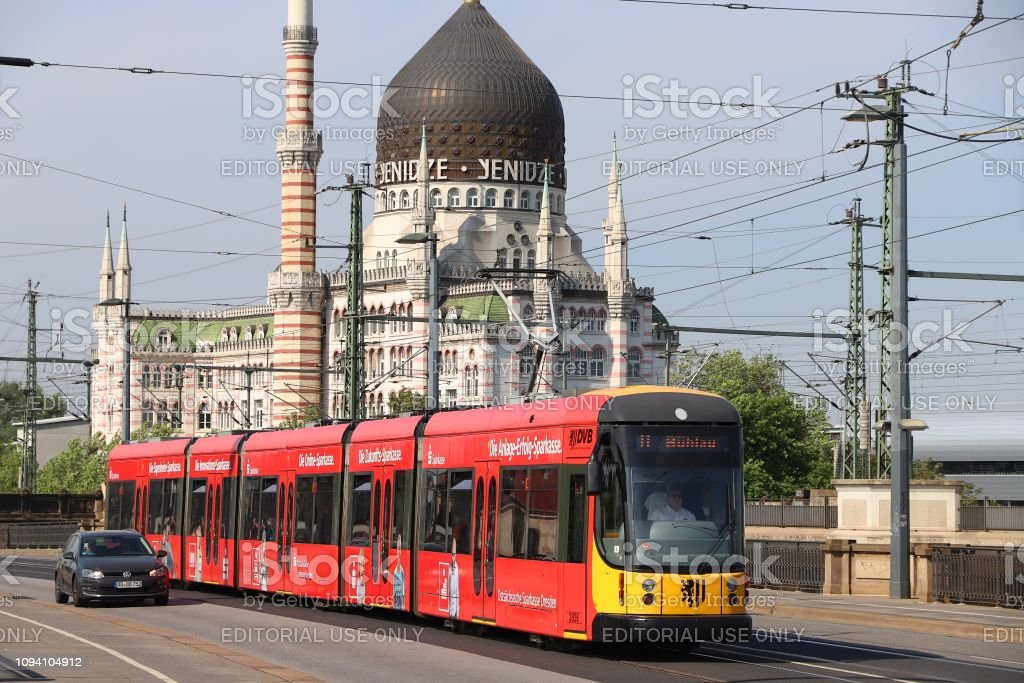 Passengers ride on public transportation electric tram in Dresden. 12...