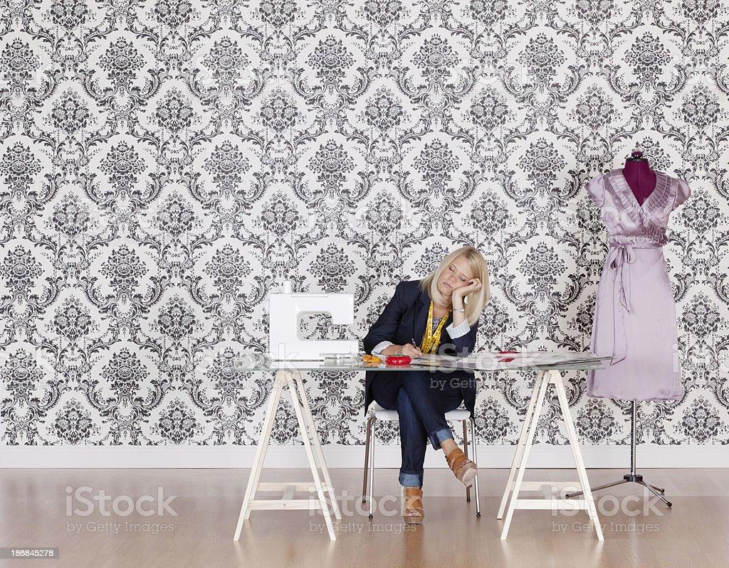 Dress designer in her studio royalty-free stock photo