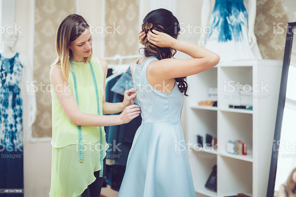 Dress fitting stock photo