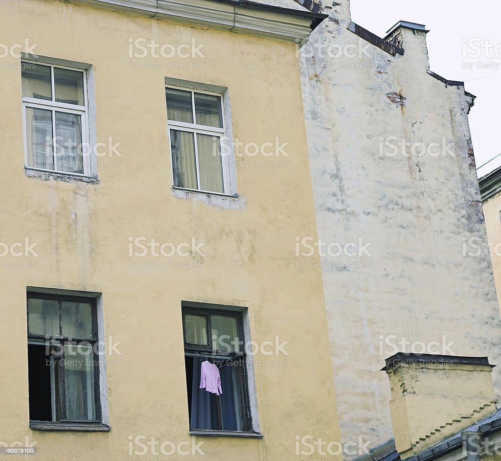 Dress in open window stock photo
