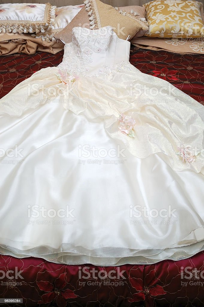Dress of the bride on a bed royalty-free stock photo
