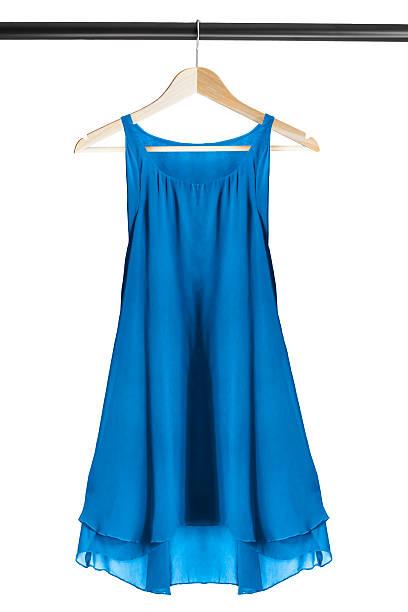 dress on clothes rack - garderobenhaken stock-fotos und bilder