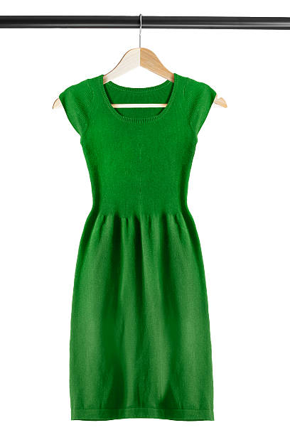 Dress on clothes rack Green knitted dress on clothes rack isolated over white dress stock pictures, royalty-free photos & images