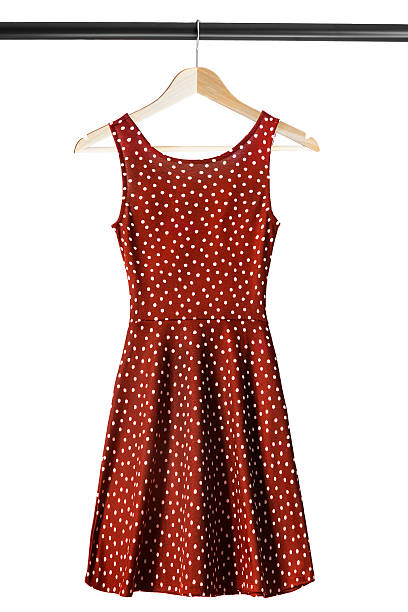 Dress on clothes rack Red silk dress on wooden clothes rack isolated over white coathanger stock pictures, royalty-free photos & images