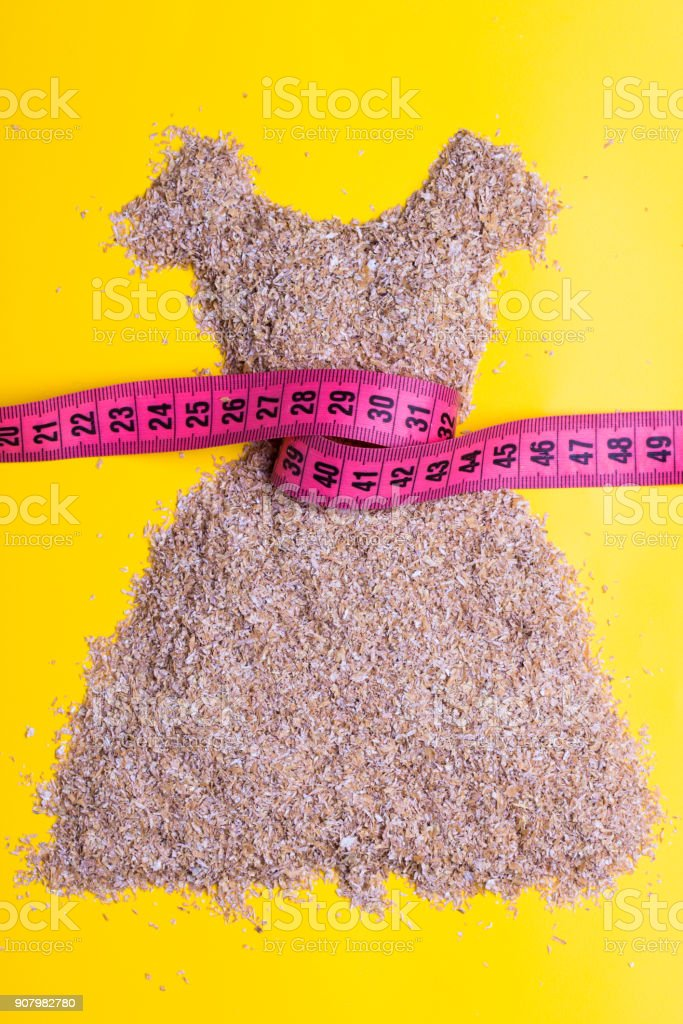 dress shape made from bran with measure tape stock photo