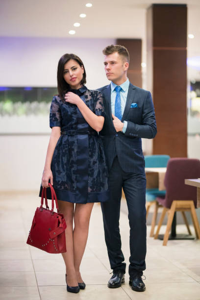 Dressed For The Special Occasion Fashion portrait of an elegant young couple. evening wear stock pictures, royalty-free photos & images