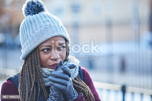 Shot of a beautiful young woman looking thoughtful on a wintery day outdoors