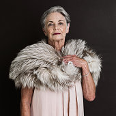Cropped studio portrait of a grand old lady isolated on black